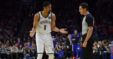 Brooklyn Nets guard Spencer Dinwiddie (8) questions a foul call to referee Steve Anderson (35) against the Philadelphia 76ers during the second quarter on March 28, 2019, in Philadelphia.