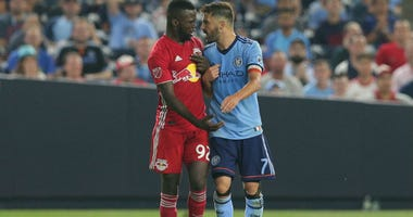 Kemar Lawrence and David Villa exchange words during the second half at Yankee Stadium.