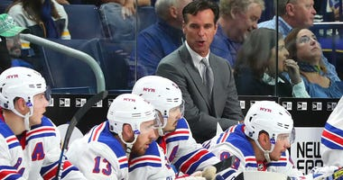 Oct 6, 2018; Buffalo, NY, USA; New York Rangers head coach David Quinn behind the bench during the third period against the Buffalo Sabres at KeyBank Center. Mandatory Credit: Kevin Hoffman-USA TODAY Sports