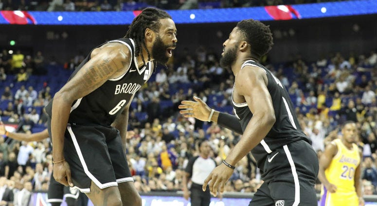 Brooklyn Nets' DeAndre Jordan, left, David Nwaba celebrate beating the Los Angeles Lakers in a preseason NBA game in Shanghai, China, Thursday, Oct. 10, 2019.