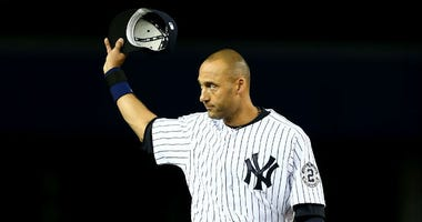 Derek Jeter #2 of the New York Yankees acknowledges the crowd against the Baltimore Orioles in his last game ever at Yankee Stadium on September 25, 2014 in the Bronx borough of New York City.