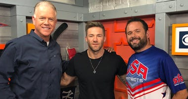 Julian Edelman poses with Boomer Esiason and Gregg Giannotti on June 25, 2019.
