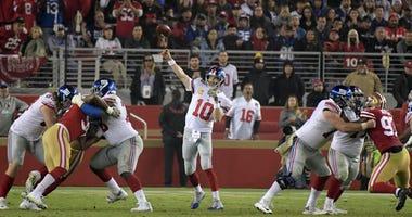 Giants quarterback Eli Manning throws a pass under pressure from San Francisco 49ers defensive tackle DeForest Buckner (99) on Nov. 12, 2018, at Levi's Stadium in Santa Clara, California.