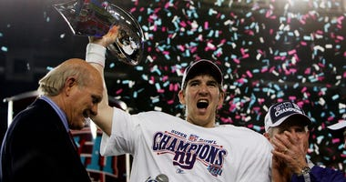 Giants quarterback Eli Manning holds the Vince Lombardi Trophy after defeating the New England Patriots 17-14 in Super Bowl XLII on Feb. 3, 2008, at University of Phoenix Stadium in Glendale, Arizona.