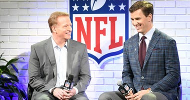 NFL commissioner Roger Goodell (left) with New York Giants quarterback Eli Manning at a fan forum event with the Walter Payton NFL Man of the Year finalists at the House of Blues in preparation for Super Bowl LI