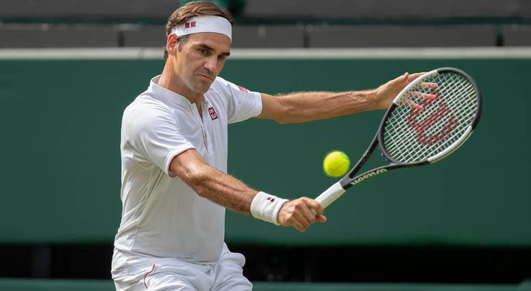 Roger Federer in action during his match against Lukas Lacko at Wimbledon on July 4, 2018, in London