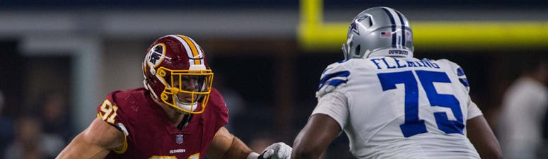 ashington Redskins outside linebacker Ryan Kerrigan (91) and Dallas Cowboys offensive tackle Cameron Fleming (75) in action during the game between the Dallas Cowboys and Washington Redskins at AT&T Stadium on Nov. 22, 2018.