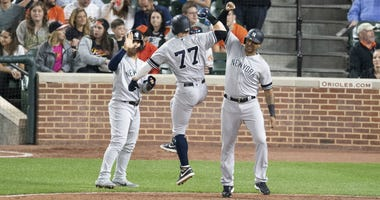 Clint Frazier celebrates with Gleyber Torres and Aaron Hicks