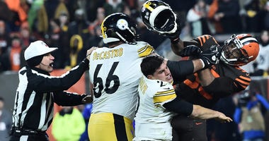 Browns defensive end Myles Garrett hits Steelers quarterback Mason Rudolph with his own helmet on Nov. 14, 2019, in Cleveland.