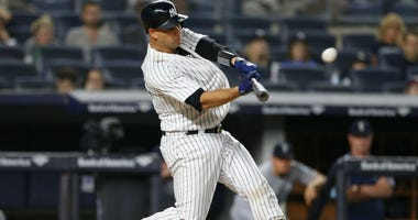 Gary Sanchez hits a two run home run in the eighth inning against the Seattle Mariners at Yankee Stadium.