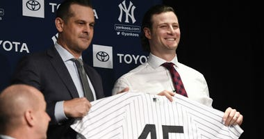 Dec 18, 2019; Bronx, NY, USA; Yankees manager Aaron Boone, left, poses with New York Yankees pitcher Gerrit Cole during a press conference at Legends Club at Yankee Stadium