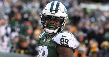 Chris Herndon #89 of the New York Jets reacts after scoring a touchdown against the Green Bay Packers