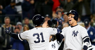 Aaron Judge celebrating with teammate Aaron Hicks at home plate