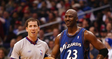 Los Angeles - February 12, 2003: Michael Jordan of the Washington Wizards talks with referee Tim Donaghy during the game against the Los Angeles Clippers
