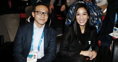 Brooklyn Nets owner Joe Tsai pictured with former United States Olympian Michelle Kwan