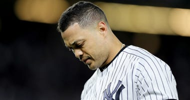 Giancarlo Stanton of the Yankees reacts after grounding out against the Minnesota Twins during the first inning in game one of the American League Division Series at Yankee Stadium on October 04, 2019 in New York City.