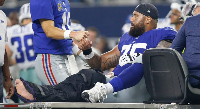 Giants center Jon Halapio is carted off the field after being injured against Dallas Cowboys on Sept. 16, 2018, at AT&T Stadium.
