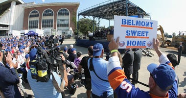 Patrick Dowd holds up a sign at the groundbreaking ceremony for the Islanders hockey arena at Belmont Park on September 23, 2019 in Elmont, New York.