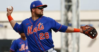Mets third baseman J.D. Davis throws to first for an out against the Detroit Tigers during the fifth inning at Publix Field at Joker Marchant Stadium in Lakeland, Florida.