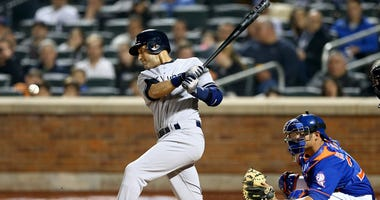 The Yankees' Derek Jeter hits an RBI single against the Mets defends on May 14, 2014, at Citi Field.