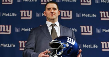 Joe Judge poses with a helmet after he was introduced as the new head coach of the New York Giants during a news conference on Jan. 9, 2020, at MetLife Stadium.
