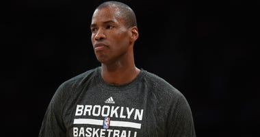 Jason Collins of the Nets looks on prior to the start of the game against the Los Angeles Lakers at Staples Center on February 23, 2014 in Los Angeles, California.
