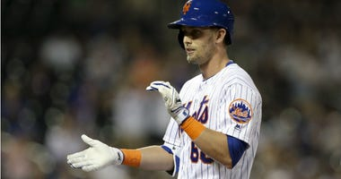 Jeff McNeil reacts after hitting a single against the San Diego Padres during the ninth inning at Citi Field.