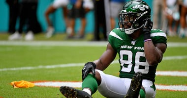 Nov 3, 2019; Miami Gardens, FL, USA; New York Jets running back Ty Montgomery (88) reacts after being penalized for running into the kicker and an apparent injury on the play during the first half at Hard Rock Stadium