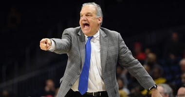 Hofstra coach Joe Mihalich points during the second half of the team's NCAA college basketball game against Northeastern for the championship of the Colonial Athletic Association men's tournament Tuesday, March 10, 2020, in Washington. Hofstra won 70-61