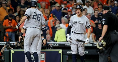 Aaron Judge of the Yankees celebrates a game-tying two-run home run by DJ LeMahieu against the Houston Astros during the ninth inning in game six of the American League Championship Series at Minute Maid Park on October 19, 2019 in Houston, Texas.