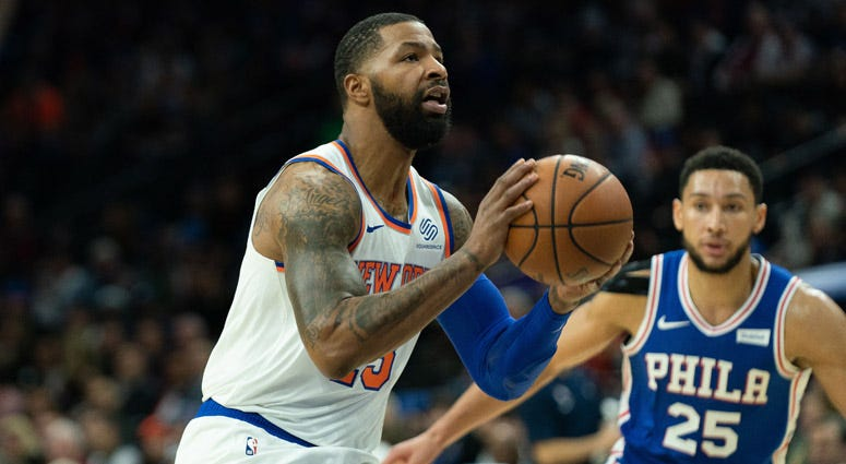 Knicks forward Marcus Morris shoots in front of 76ers guard Ben Simmons on Nov. 20, 2019, at Wells Fargo Center.