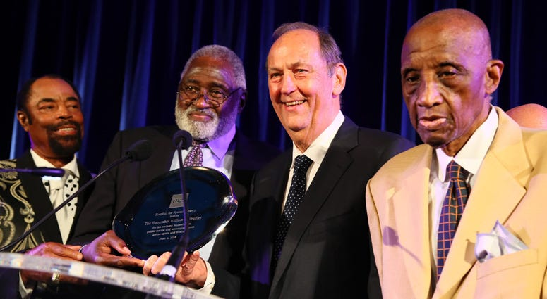 """Former Knicks Walt """"Clyde"""" Frazier, Willis Reed, Bill Bradley and Dick Barnett appear on stage at the Hospital for Special Surgery 35th Tribute Dinner at the American Museum of Natural History on June 4, 2018."""