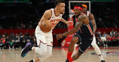 The Knicks' Kevin Knox dribbles past Bradley Beal of the Wizards on March 10, 2020, in Washington.