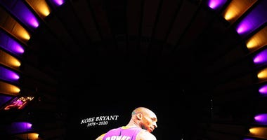 A moment of silence is held for former Lakers great Kobe Bryant before the game between the Knicks and Nets at Madison Square Garden on Jan. 26, 2020.
