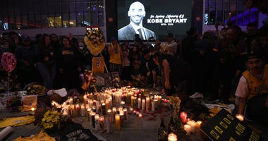 Fans gather at LA Live in Los Angeles to pay tribute to Kobe Bryant, who died earlier in a helicopter crash on Jan. 26, 2020.