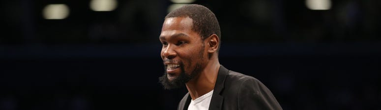 Brooklyn Nets small forward Kevin Durant (7) smiles during a time out during the second quarter against the Phoenix Suns at Barclays Center