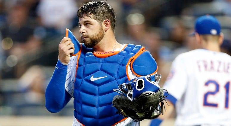 Aug 2, 2018; New York City, NY, USA; New York Mets catcher Kevin Plawecki (26) reacts after dropping a foul ball against the Atlanta Braves during the third inning at Citi Field. Mandatory Credit: Adam Hunger-USA TODAY Sports