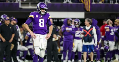 Minnesota Vikings quarterback Kirk Cousins (8) looks on during the fourth quarter against the Green Bay Packers at U.S. Bank Stadium