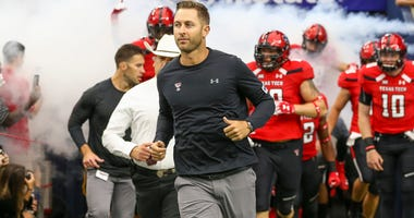 Sep 1, 2018; Houston, TX, USA; Texas Tech Red Raiders head coach Kliff Kingsbury leads the team onto the field before the game against the Mississippi Rebels at NRG Stadium. Mandatory Credit: Troy Taormina-USA TODAY Sports