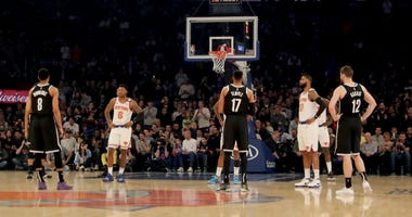 The Knicks and Nets each wait out the 24 second clock in honor of Kobe Bryant of the Los Angeles Lakers in the opening two plays at Madison Square Garden on January 26, 2020 in New York City.