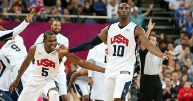 Kobe Bryant #10 of United States reacts with teammate Kevin Durant #5 after Bryant makes a three-pointer in the second half against Australia during the Men's Basketball quaterfinal game on Day 12 of the London 2012 Olympic Games at North Greenwich Arena