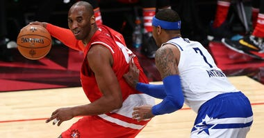 Kobe Bryant of the Los Angeles Lakers and the Western Conference handles the ball against Carmelo Anthony of the Knicks and the Eastern Conference in the first half during the NBA All-Star Game 2016 at the Air Canada Centre on February 14.