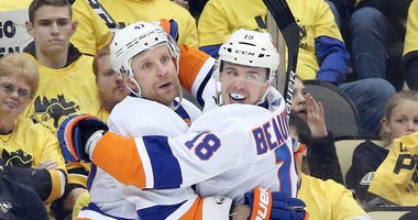 Apr 14, 2019; Pittsburgh, PA, USA; New York Islanders left wing Anthony Beauvillier (18) congratulates right wing Leo Komarov. Mandatory Credit: Charles LeClaire-USA TODAY Sports