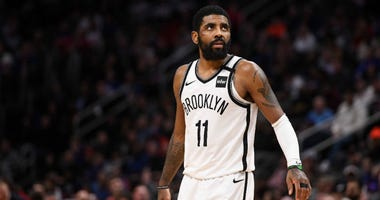 Brooklyn Nets guard Kyrie Irving (11) reacts during overtime against the Detroit Pistons at Little Caesars Arena