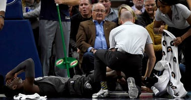 Nets guard Caris LeVert (22) is tended to after an injury during the second quarter of an NBA basketball game against the Minnesota Timberwolves on Nov. 12, 2018, in Minneapolis.