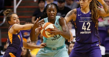 Mercury's Leilani Mitchell (5) and Brittany Griner (42) double-team Liberty's Tina Charles (31) during the first half at Talking Stick Resort Arena in Phoenix, Ariz. on Aug. 19, 2018.