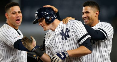 The Yankees' Gary Sanchez (left) and Gleyber Torres (right) celebrate with DJ LeMahieu after his walk-off single against the Seattle Mariners on May 7, 2019, at Yankee Stadium.