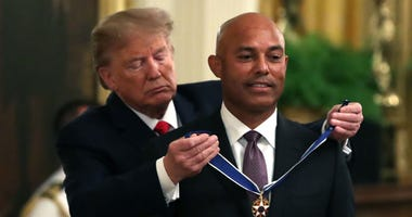 President Donald Trump presents the Presidential Medal of Freedom to former Yankees pitcher Mariano Rivera on Sept. 16, 2019, at the White House.