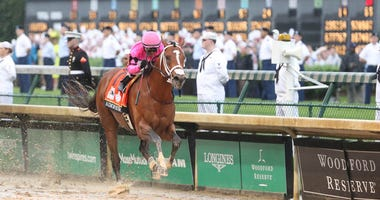 Luis Saez aboard Maximum Security crosses the finish line during the 145th running of the Kentucky Derby at Churchill Downs.