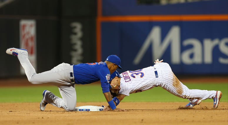 The Mets' Michael Conforto is tagged out by the Cubs' Addison Russell on an attempted steal during the sixth inning on Aug. 29, 2019.